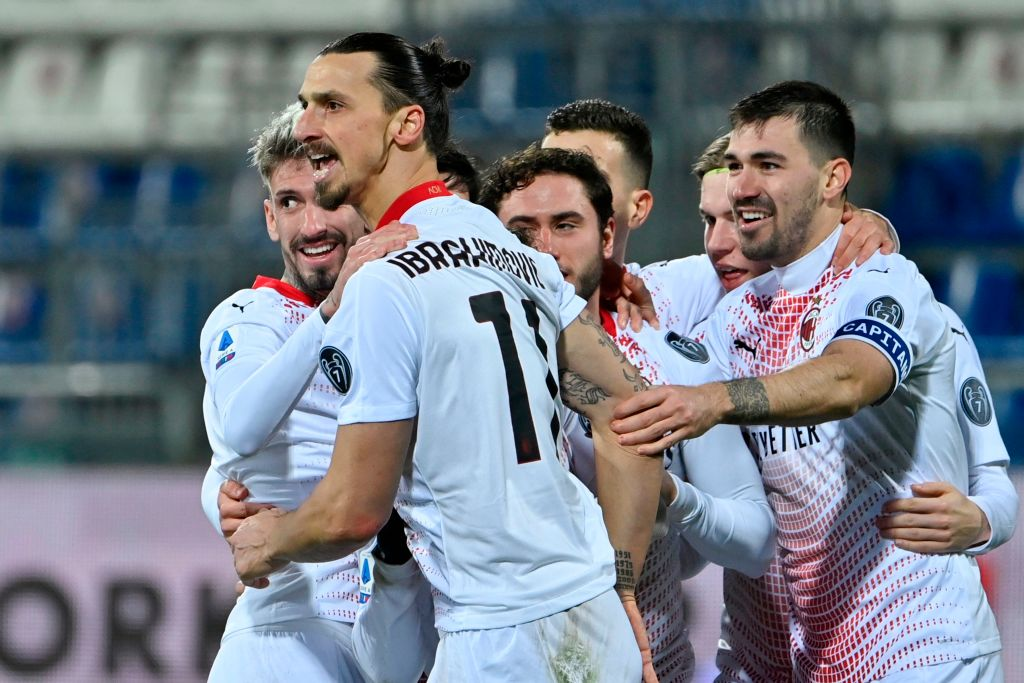 IBRAHIMOVIC'S DOUBLE HELP AC MILAN EDGE CAGLIARI, SENDS MILAN BACK TO TOP OF TABLE.