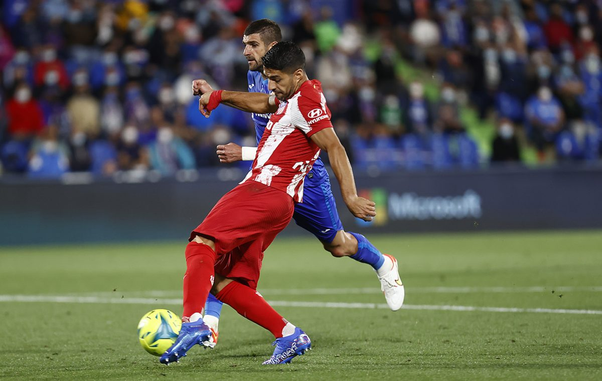 Suarez double gives Atletico win at Getafe in Spain
